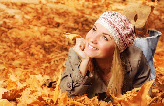 Cheerful teen on fall foliage