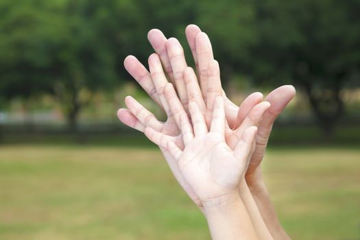 all family's hands together