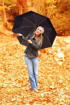 Beautiful female under umbrella