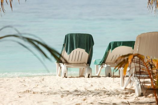 Empty chaise lounge on beach