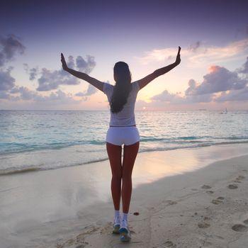 Woman in sportswear on beach