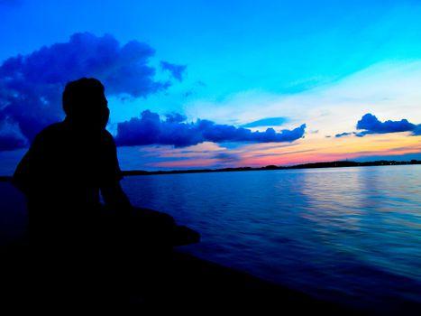 Fisherman in twilight sunset