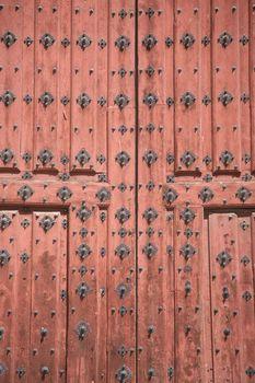 detail of red ancient wood door