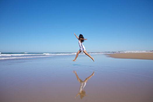 jumping woman at seashore