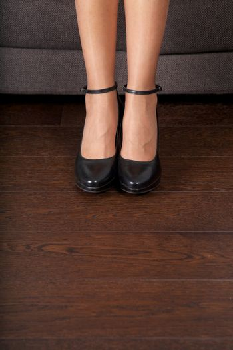 minimal heeled black shoes on parquet