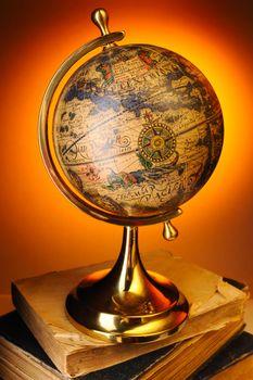Antique globe on books
