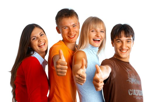 Four young people on white background laughing and giving the thumbs-up sign.