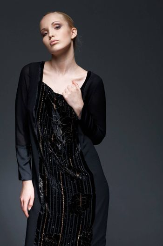 Portrait of a beautiful elegant model in black dress, posing.