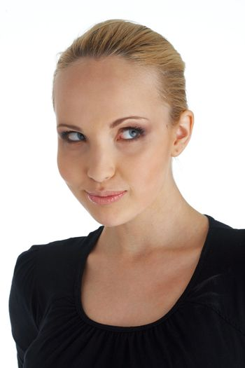 Close-up portrait of blond young woman looking away.
