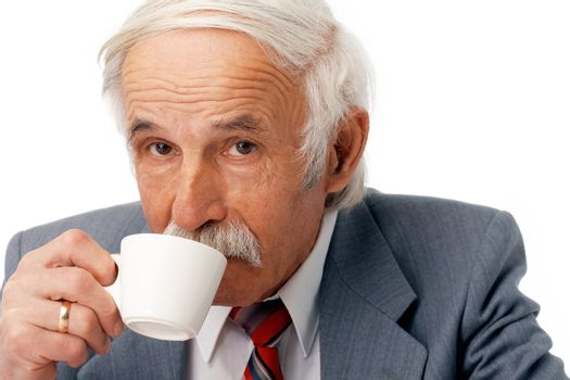 Portrait of an elder businessman drinking coffee over white.