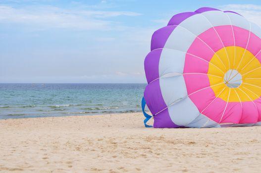 Beach at the sea and the para-glider.