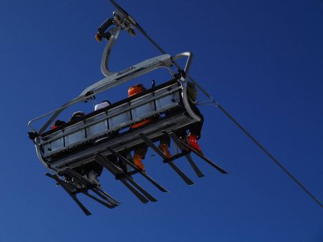 Ski lift carrying skiers.