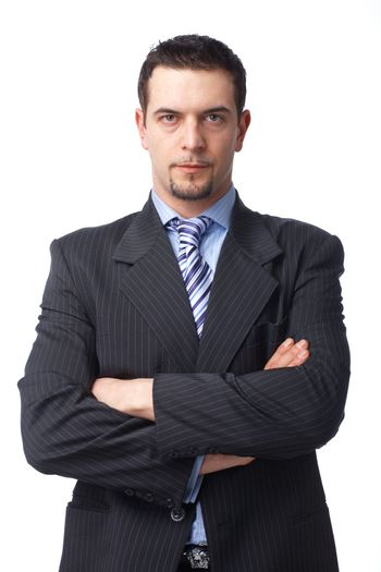 Portrait of a confident mature  business man with hands folded on white background