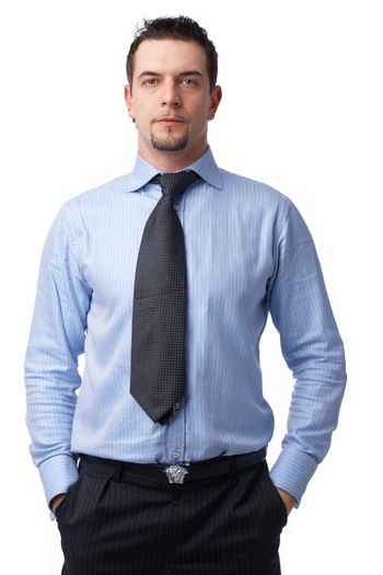 Portrait of a confident businessman standing with his hands in the pockets on white.