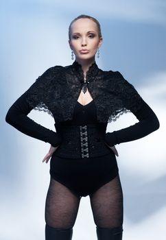 Portrait of glamour model in black corset posing