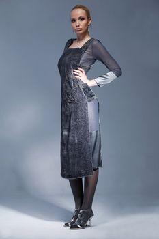 Portrait of a beautiful model dressed in vintage dress, posing.