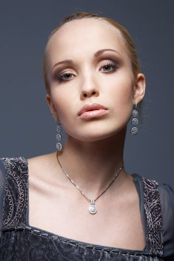 Close-up portrait of a model with vintage jewellery.