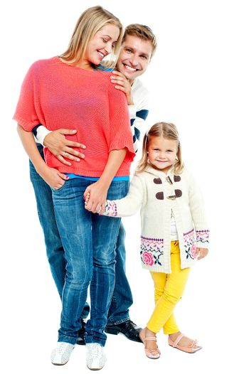 Two young parents with pretty daughter