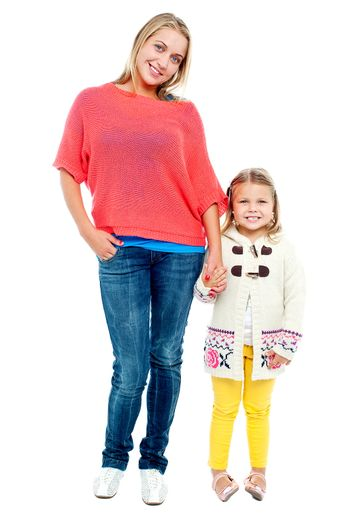 Mum and daughter posing in trendy outfits