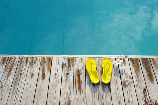 Sandals by a swimming pool
