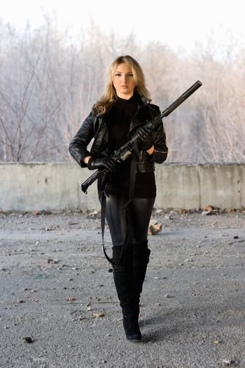 Pretty girl with a rifle