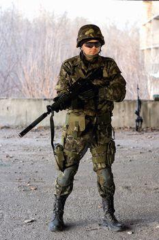 Military guy holding a gun