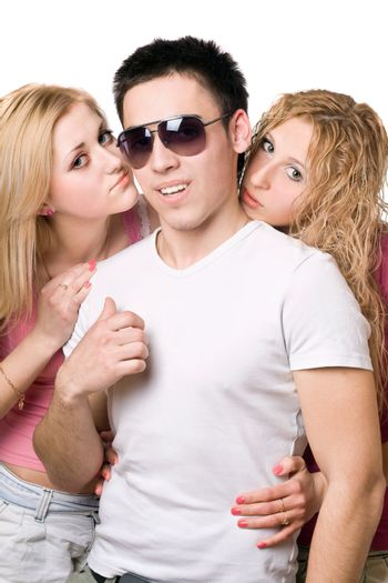 Portrait of a two attractive blonde women with handsome young man