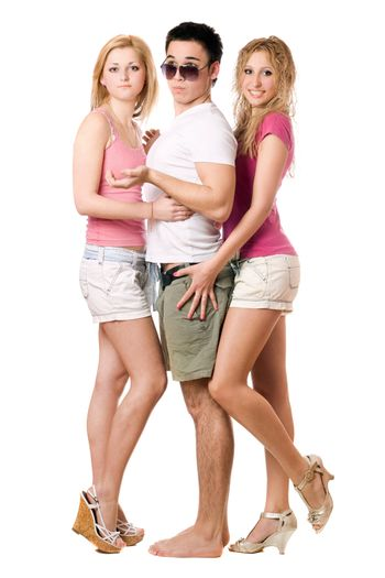 Handsome young man and two attractive girls. Isolated