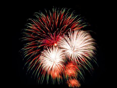 fireworks explode at night