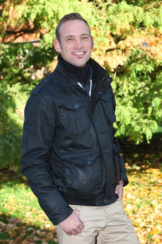 Cheerful handsome man in woodland