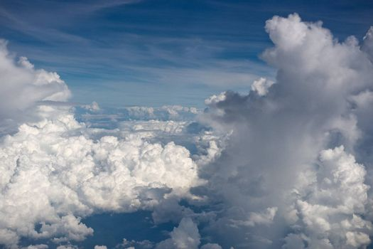 Aerial view on white fluffy clouds