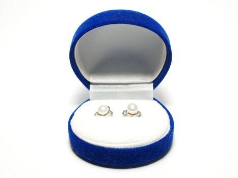 Earrings in a blue box