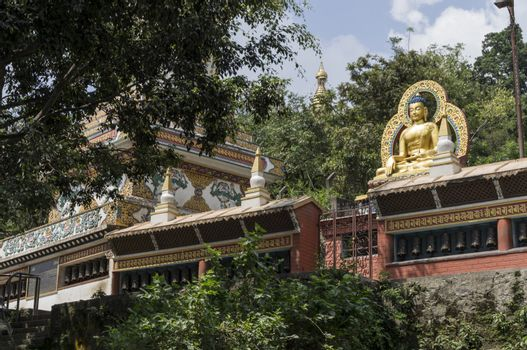 Buddhist temple in kathmandu, nepal with big sitting buddha on top