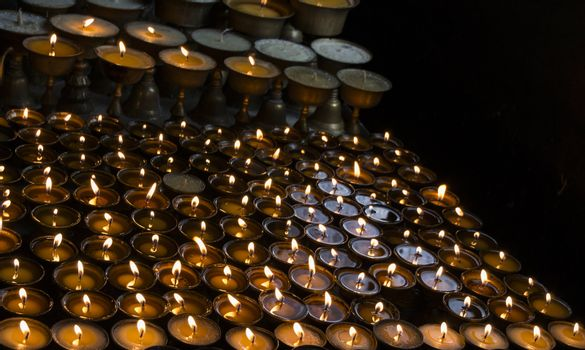 many candles in a row, dark background