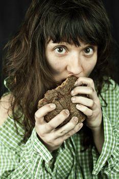 poor beggar woman eating bread