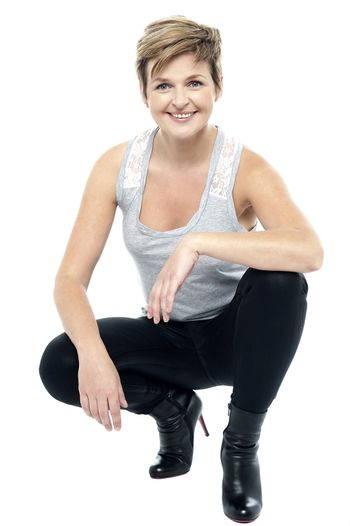 Charming woman in squatting posture