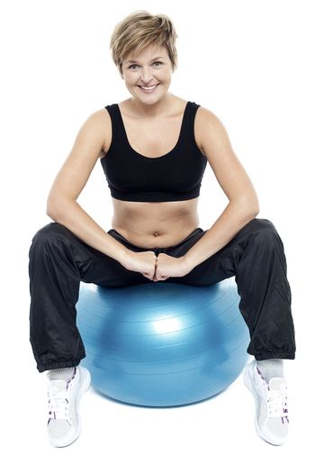 Fitness woman relaxing on exercise ball