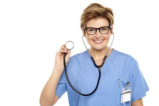 Senior female physician ready to examine you
