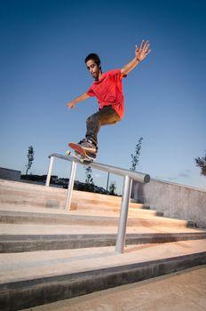 Skateboarder on rail