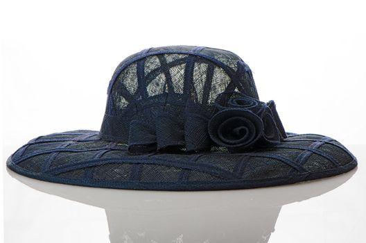 Vintage hat on white reflective background.
