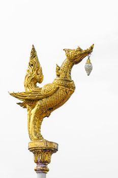Golden statue of creature