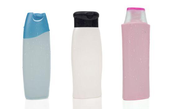 Three blank shampoo bottles