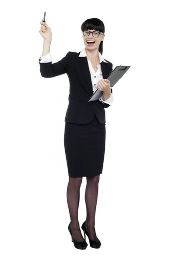 Cheerful businesswoman posing with raised arm