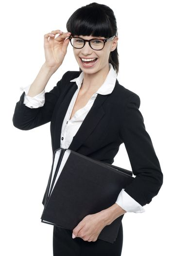 Professional woman in formal attire carrying files