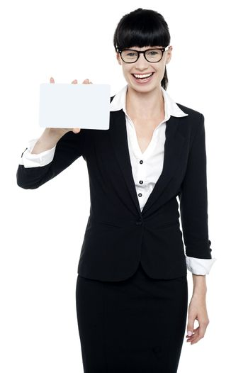 Pretty corporate woman showing blank placard