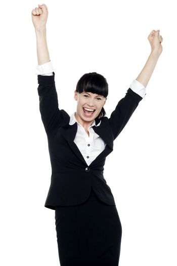 Jubilant corporate lady throwing up her hands