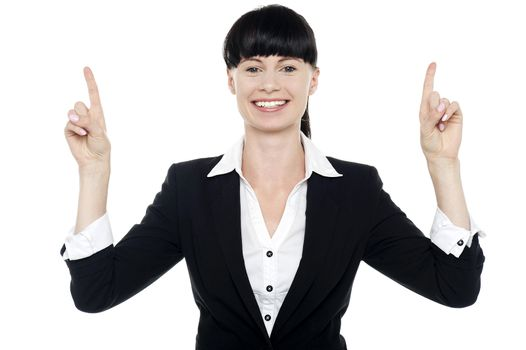 Smiling woman posing with raised fingers