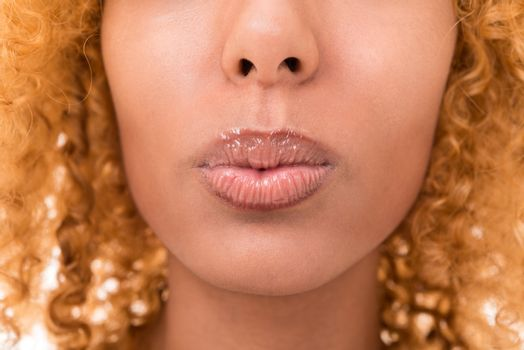 lips of a young woman is very close