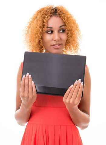 young woman in a red dress holding a laptop