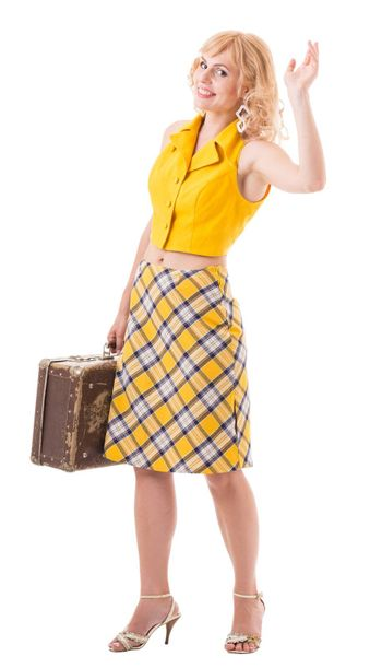 young woman in a yellow retro costume. Isolated with clipping path